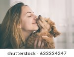 young girl kissing her good... | Shutterstock . vector #633334247