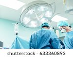 team of surgeons operating in... | Shutterstock . vector #633360893