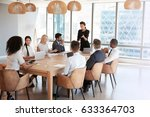 businesswoman stands to address ... | Shutterstock . vector #633364703
