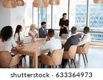 businesswoman stands to address ... | Shutterstock . vector #633364973