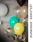Small photo of vintage air balloon and paper airship like decoration for birthday party. Valentines day greeting . bachelorette party, communion, christening, wedding decor. Happiness concept