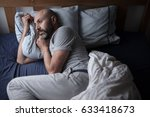 mid forties depressed man in... | Shutterstock . vector #633418673