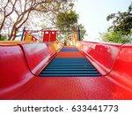 kids playing slide | Shutterstock . vector #633441773
