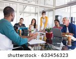 business people discussing at... | Shutterstock . vector #633456323