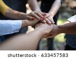 group of diverse hands together ... | Shutterstock . vector #633457583
