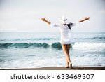 beautiful girl on the beach.... | Shutterstock . vector #633469307