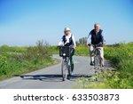 senior couple riding bike... | Shutterstock . vector #633503873