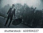 Sad Man With Rose Under The Rain