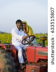a rural couple on a tractor   | Shutterstock . vector #633515807