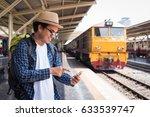 young tourist man using... | Shutterstock . vector #633539747
