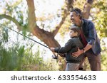 smiling father assisting son... | Shutterstock . vector #633554633