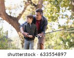 father and son fishing on sunny ... | Shutterstock . vector #633554897
