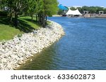 Small photo of Cranes Roost Park in Altamonte Springs shore with rocks and trees and concert pavilion in the background