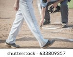 umpire cleans home plate as...   Shutterstock . vector #633809357