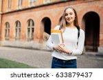 female college student. happy... | Shutterstock . vector #633879437