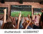 rear view of friends watching... | Shutterstock . vector #633884987