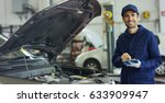specialist auto mechanic in the ...   Shutterstock . vector #633909947