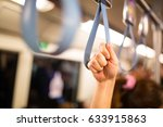 passeger us hang  holding in... | Shutterstock . vector #633915863
