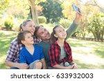 happy family taking a selfie in ... | Shutterstock . vector #633932003