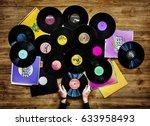 hands holding music vinyl... | Shutterstock . vector #633958493