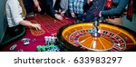 people play poker roulette at... | Shutterstock . vector #633983297