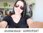 selfie thai woman  self portrait | Shutterstock . vector #634019267