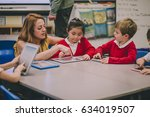 group of students in a primary... | Shutterstock . vector #634019507