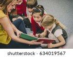 teacher is sitting in the...   Shutterstock . vector #634019567