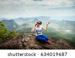 women travel sit on a cliff on...   Shutterstock . vector #634019687