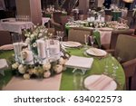 glasses stand on green table in ... | Shutterstock . vector #634022573