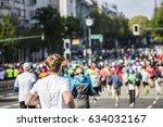 marathon runners in the city  | Shutterstock . vector #634032167