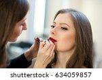 makeup artist makes beautiful... | Shutterstock . vector #634059857