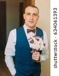 stylish dressed man holding... | Shutterstock . vector #634061393
