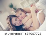 young mother sitting with her... | Shutterstock . vector #634067723