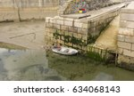 small boat in harbour at low... | Shutterstock . vector #634068143