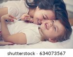 young mother playing with her... | Shutterstock . vector #634073567