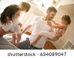 cheerful family playing...   Shutterstock . vector #634089047