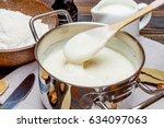 bechamel sauce in a pan and... | Shutterstock . vector #634097063