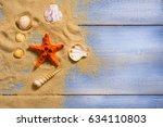 sea shell on wooden floor ...   Shutterstock . vector #634110803