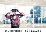 young man with virtual reality... | Shutterstock . vector #634111253