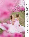 mother with her daughter in... | Shutterstock . vector #634124813