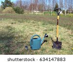 shovel and watering can on... | Shutterstock . vector #634147883