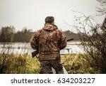 hunter with a gun tracks down...   Shutterstock . vector #634203227