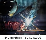 welder working with automatic... | Shutterstock . vector #634241903
