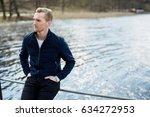 attractive pensive man wearing...   Shutterstock . vector #634272953