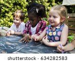 group of children are in a... | Shutterstock . vector #634282583