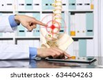hand doctor pointing the... | Shutterstock . vector #634404263