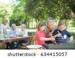 man with kids cooking barbecue... | Shutterstock . vector #634415057