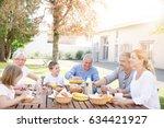 family of 6 having breakfast...   Shutterstock . vector #634421927