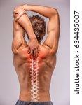 back pain  man's back on. | Shutterstock . vector #634435007